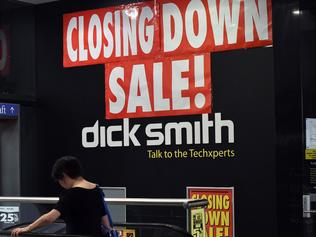 A woman enters a Dick Smith store during a closing down sale in the central business district of Sydney on April 21, 2016. The Reserve Bank has slashed rates by 275 basis points since November 2011 to boost the economy, but it has been almost a year since its last cut in May 2015. / AFP PHOTO / SAEED KHAN