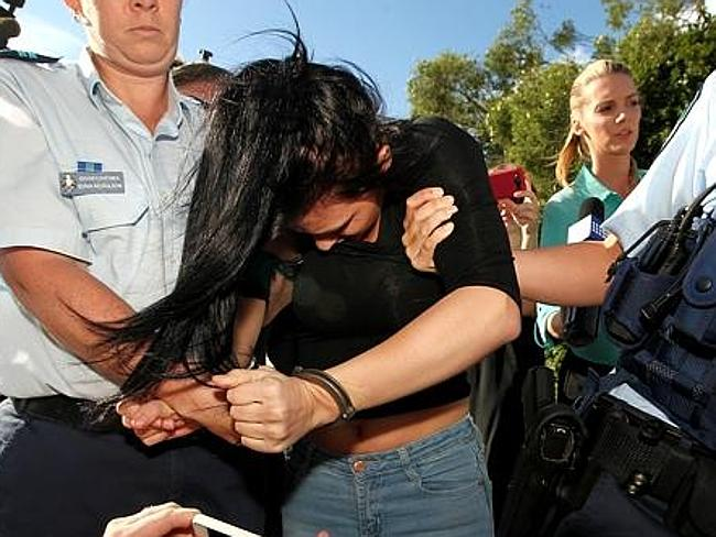 One of two women allegedly involved in the incident leaves the Coolangatta Police Station