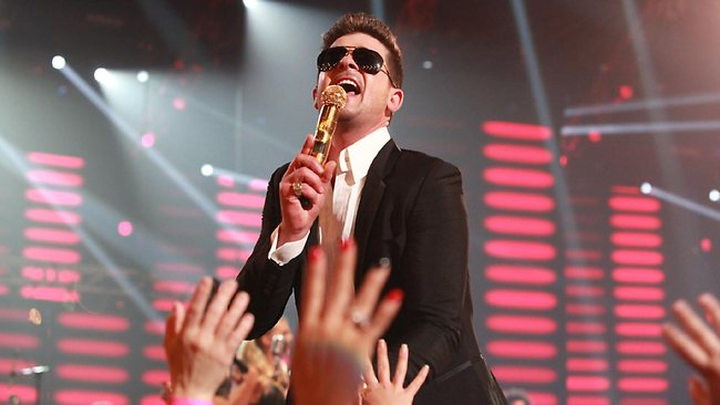 Perhaps the creepiest performance of the night - Robin Thicke strutted out on stage with dark sunnies and skimpy girls.