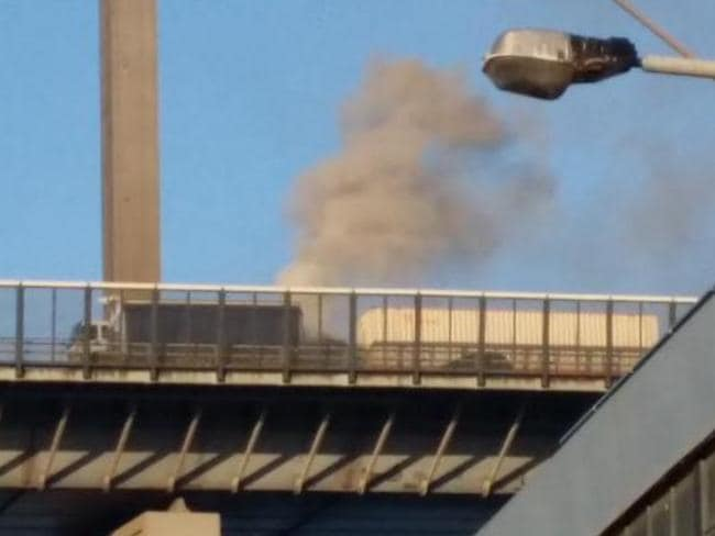 A truck caught fire on the West Gate Bridge this morning.