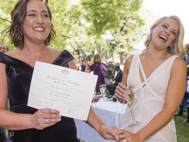 A certificate is signed with 'groom' crossed out in Victoria's first legal same sex wedding. Picture: Jason Edwards