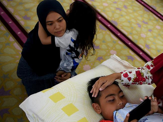 A Malaysian boy is comforted by his mother after being circumcised during a ceremony at the Bandar Tun Hussein Onn mosque in Kuala Lumpur. Picture: AFP
