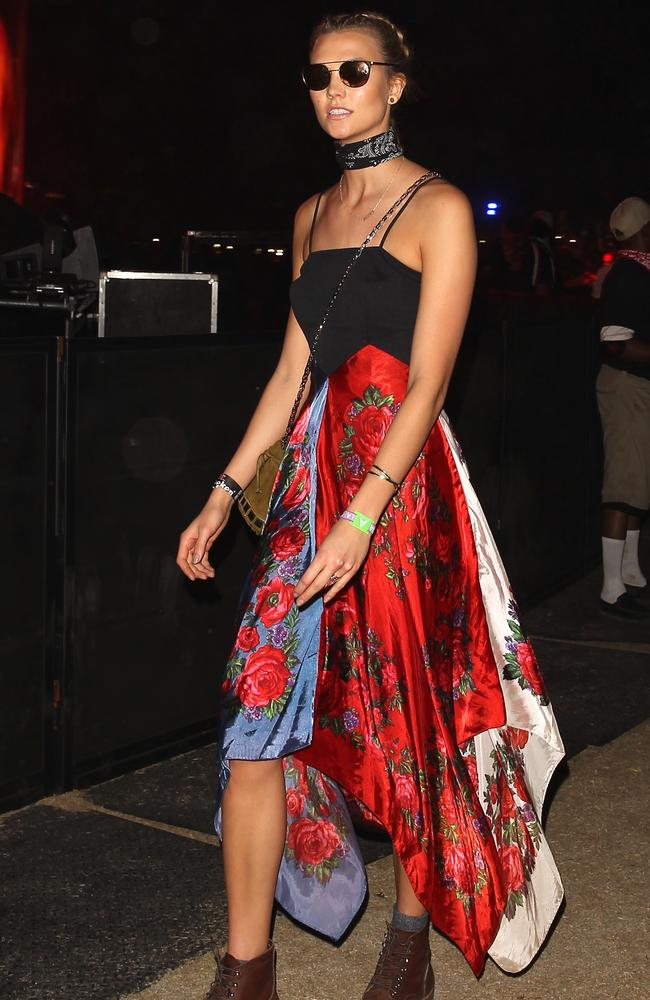 Karlie Kloss was a major fashion statement while walking to a set during the last day of the festival. The supermodel's outfit was like grunge meets boho in dress form. She smiled and showed off her boxer braids with her simple but edgy look. Picture: BackGrid