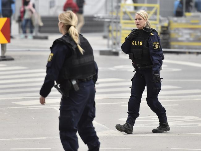 Police attend the scene after a truck crashed into a department store injuring several people in central Stockholm, Sweden. Picture: AP.