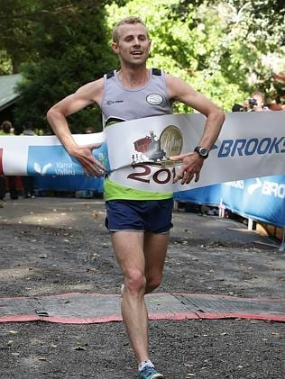Men's winner Craig Appleby crosses the finish line in Emerald. Picture: Hamish Blair