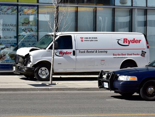 A van with a damaged front-end is shown on the footpath where the driver was taken into custody. Picture: AP