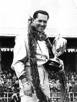 Sir Jack Brabham holds the trophy after winning the International Daily Express race at Silverstone in 1964.