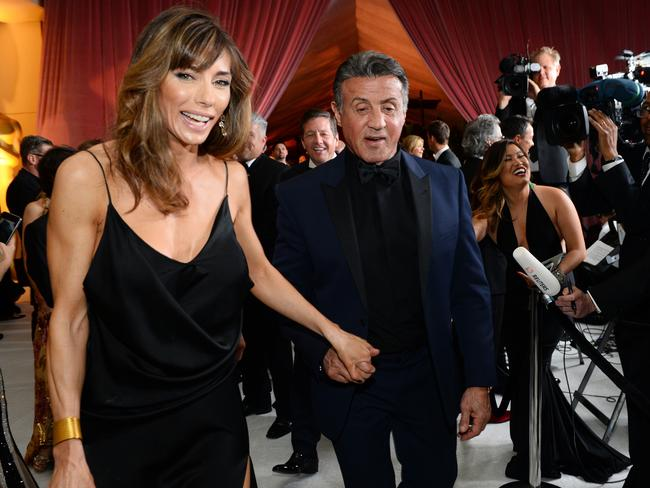 Jennifer Flavin, left, and Sylvester Stallone attend the Governors Ball after the Oscars on Sunday, Feb. 28, 2016, at the Dolby Theatre in Los Angeles. Picture: Al Powers/Invision/AP