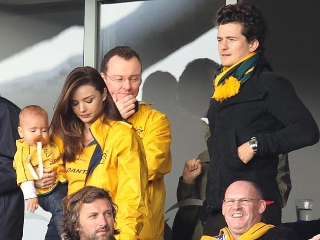 Australian model Miranda Kerr holds her son Flynn as her husband and actor Orlando Bloom, right, watch the Pool C in Auckland,