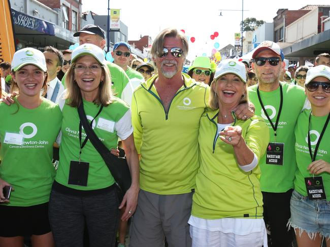 Olivia Newton-John and her husband John Easterling walk in Ivanhoe to raise money for the Olivia Newton John Cancer and wellness centre in 2015. Picture: David Crosling