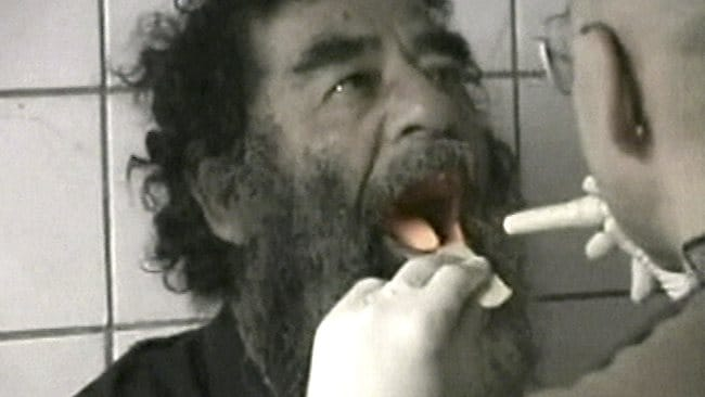 This December 14, 2003 file image taken from video, captured former Iraqi leader Saddam Hussein undergoes medical examinations in Baghdad.