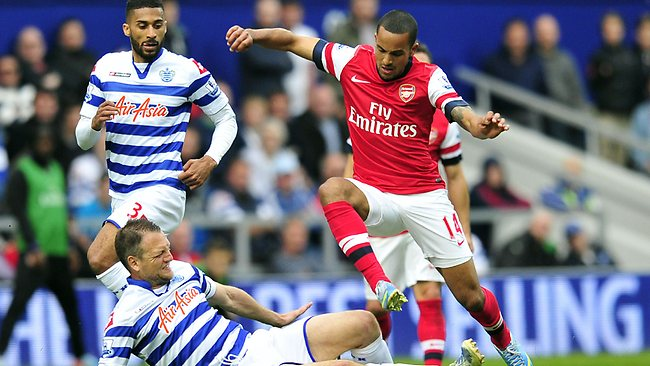 Queens Park Rangers' Clint Hill (L) vies with Arsenal's English striker Theo Walcott during the English Premier League match at Loftus Road. Arsenal won 1-0. Picture: Glyn Kirk