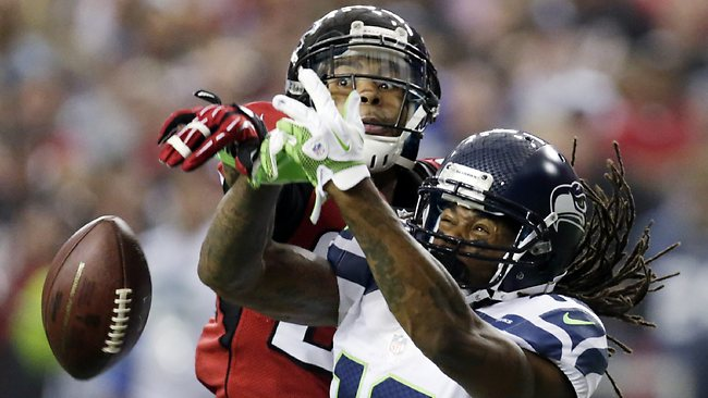 Atlanta Falcons free safety Thomas DeCoud breaks up a pass intended for Seattle Seahawks wide receiver Sidney Rice in the NFC divisional playoff NFL game in Atlanta. The Falcons won 30-28. Picture: Dave Martin
