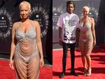 Amber Rose and partner rapper Wiz Khalifa walk the red carpet at the 2014 Video Music Awards, the VMAs. Picture: Getty