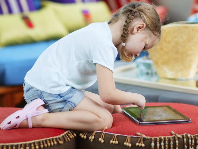 Educational ... A young girl plays on an Apple ipad. Picture: Thinkstock