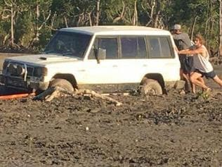 Supplied Editorial A car load of tourists had to be pulled from the mud at Gunn Point after they became bogged.