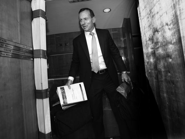 "Tony Abbott in Sydney on day two after the election. here he is holding a copy of the ""Incoming Government Brief 2013"". Picture: Gary Ramage"