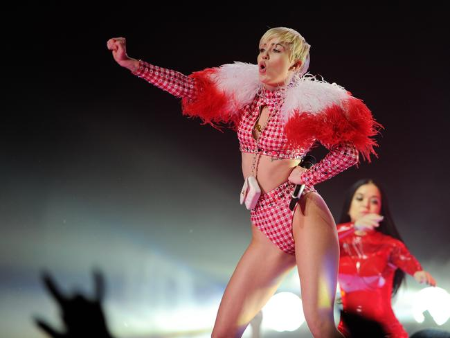 Regrets? ... Cyrus performs at the Barclays Centre in New York for her Bangerz world tour. Picture: AP