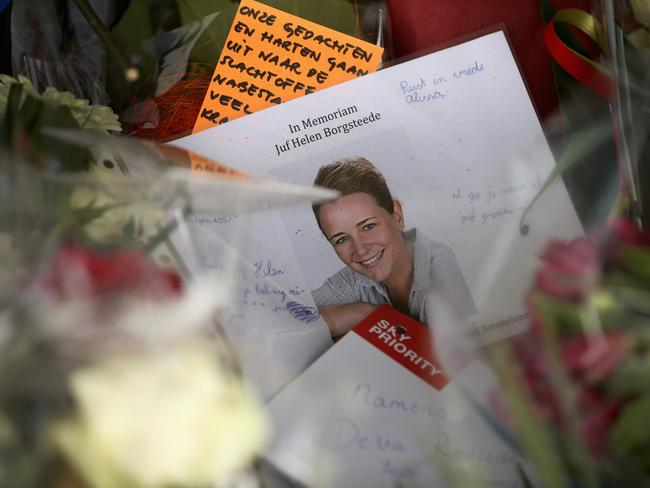 Identification process ... a photograph of Dutch school teacher Juf Helen Borgsteede sits amongst floral tributes at Schiphol Airport in memory of the victims of Malaysia Airlines flight MH17. Picture: Christopher Furlong