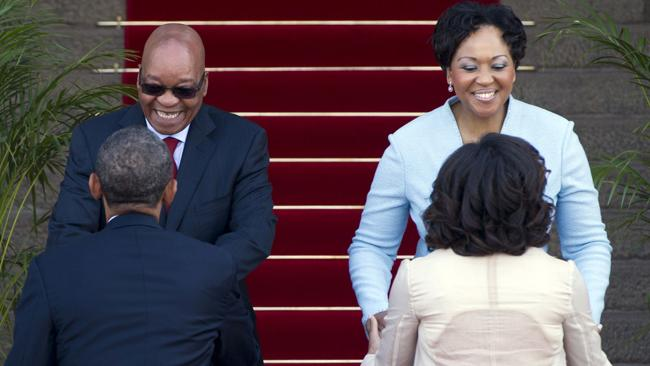 South African President Jacob Zuma and his wife, Thobeka Madiba-Zuma greet US President Barack Obama and First Lady Michelle Obama as they arrive at the Union Building in Pretoria, South Africa, on June 29, 2013. AFP PHOTO