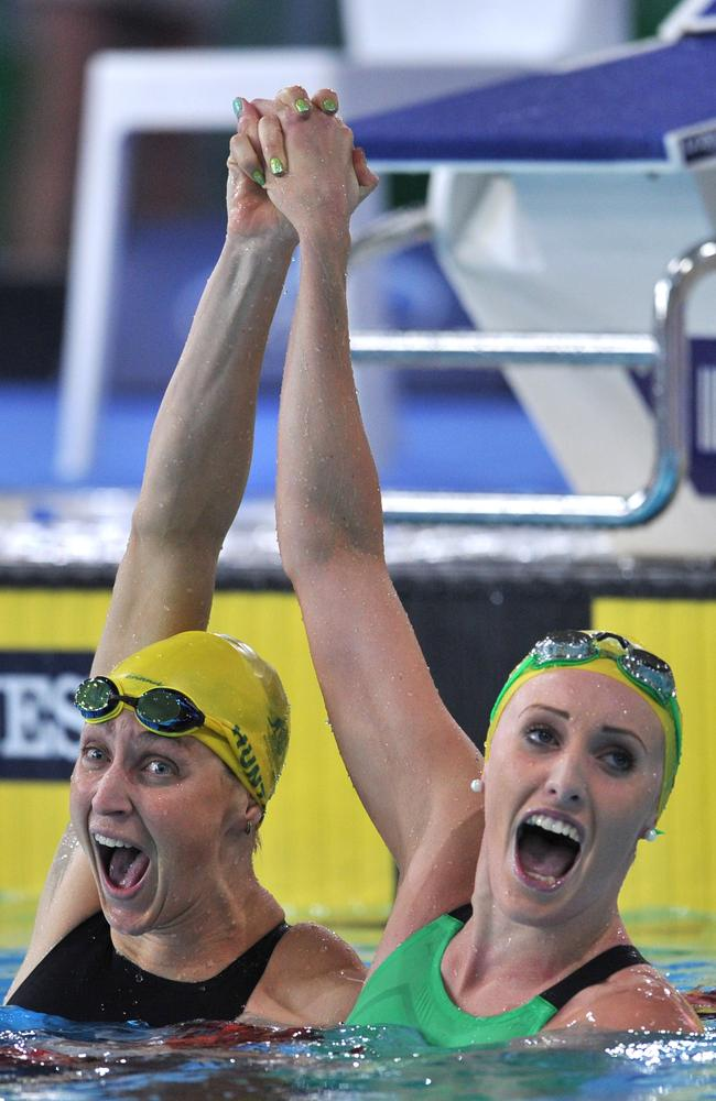 Taylor McKeown celebrates taking gold with silver medallist Australia's Sally Hunter.