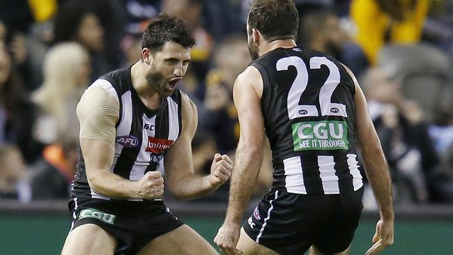 Alex Fasolo celebrates a goal with Steele Sidebottom.