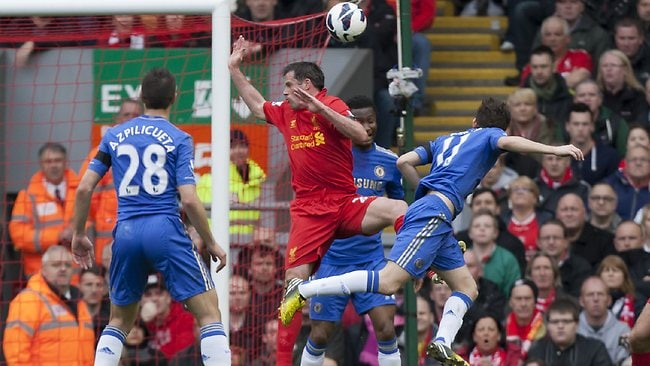 Chelsea's Oscar, centre right, scores against Liverpool during their English Premier League 2-2 draw at Anfield Stadium. Picture: Jon Super