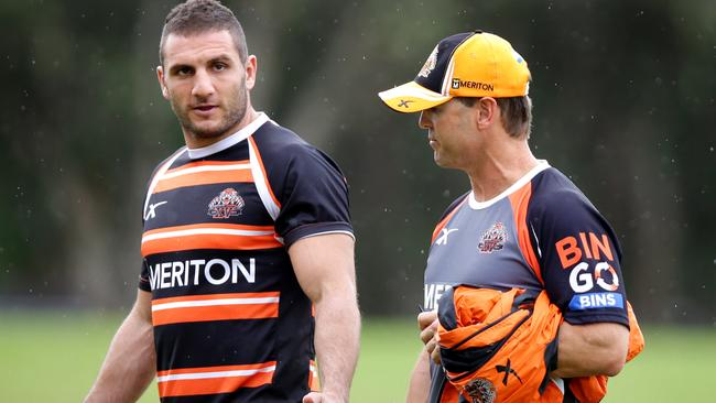 Tiger's Robbie Farah and coach Mick Potter during a Tigers training session.