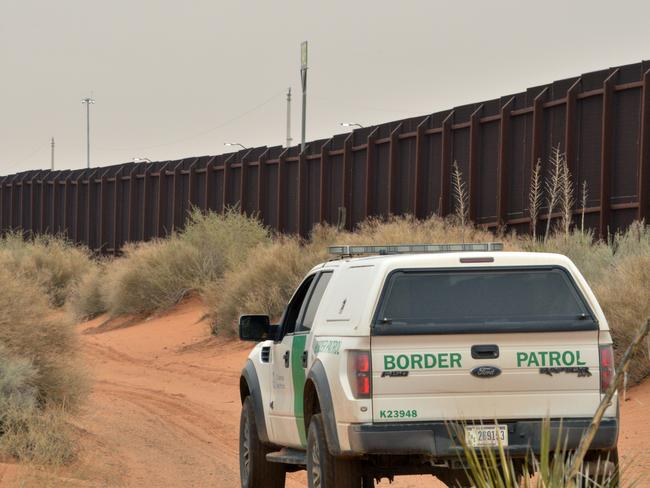 Strong position ... Donald Trump wants to raise the height, and extend, the existing fence separating the US and Mexico. Picture: AP/Russell Contreras