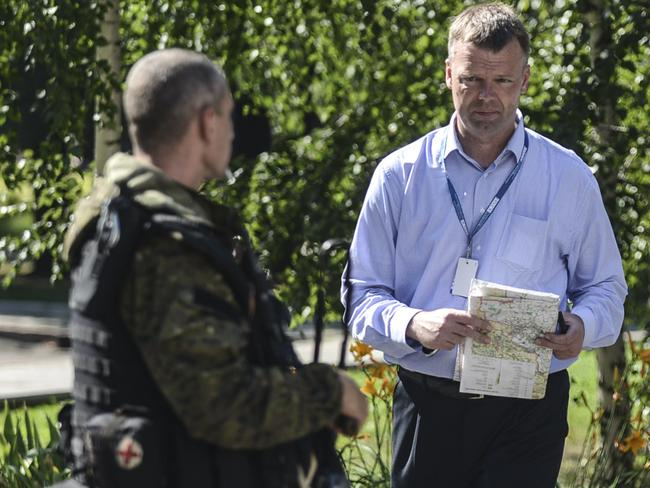 Search still not possible ... Alexander Hug, Deputy Chief Monitor of the Organisation for Security and Cooperation in Europe (OSCE) Special Monitoring Mission to Ukraine, holds a map in Donetsk. Picture: AFP
