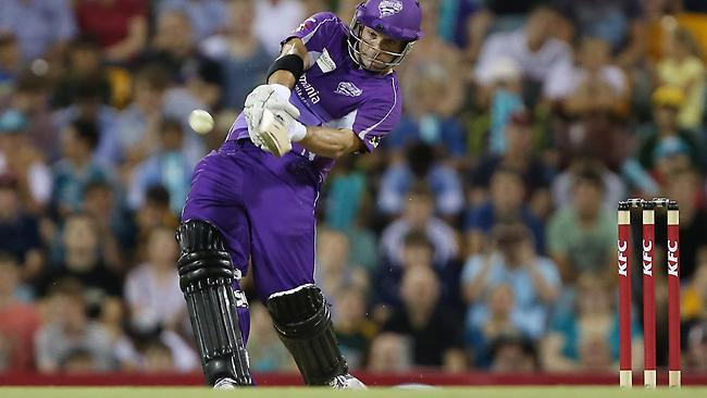 Hurricanes batsman Travis Birt launches a shot against the Heat at the Gabba. Picture: Chris Hyde