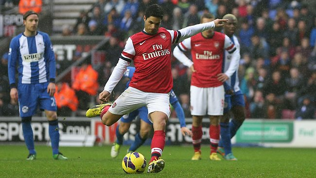 Mikel Arteta scores from the spot for Arsenal against Wigan.