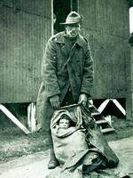 March 1919. Tim Tovell with 'Digger' Henri Young, in the sack he used to smuggle him into England.
