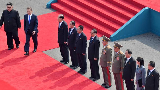 The two leaders walk down a red carpet past representatives from the North to the official summit Peace House building at Panmunjom. Picture: AFP/Korea Summit Press Pool