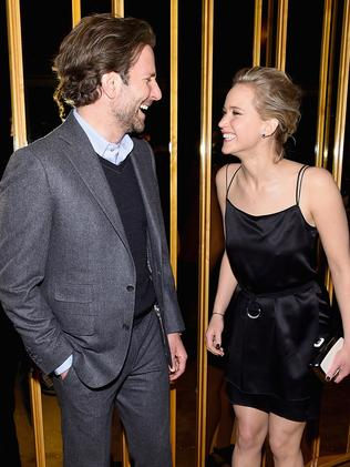 "Bradley Cooper and Jennifer Lawrence at a ""Serena"" after party"