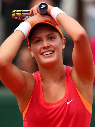 Eugenie Bouchard rejoices after beating Carla Suarez Navarro.