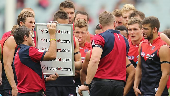 Demons coach Mark Neeld speaks to his team at three-quarter time last Saturday.