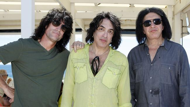 Made under ... Kiss members Tommy Thayer, Paul Stanley and Gene Simmons off duty in Adelaide in 2013.