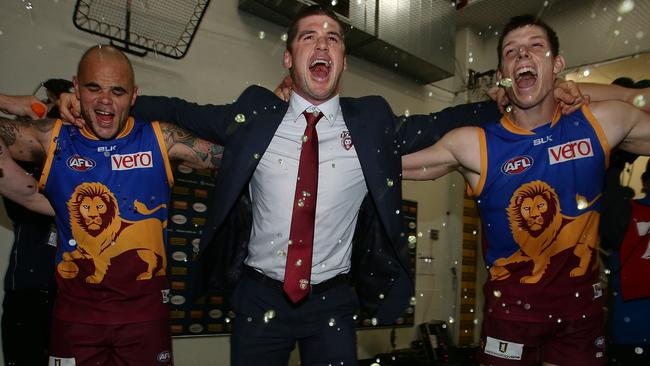 Jonathan Brown belts out the team song after the emotional win over North Melbourne. Picture: Peter Wallis