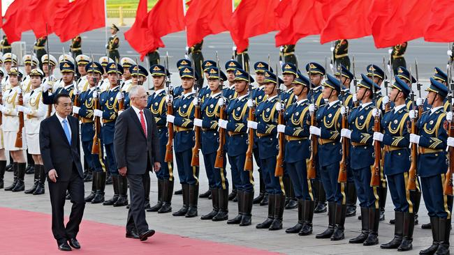 Prime Minister Malcolm Turnbull inspects the troops with Premier Li Keqiang outside Beijing's Great Hall of the People on his first official visit to China. Picture: Stephen Cooper