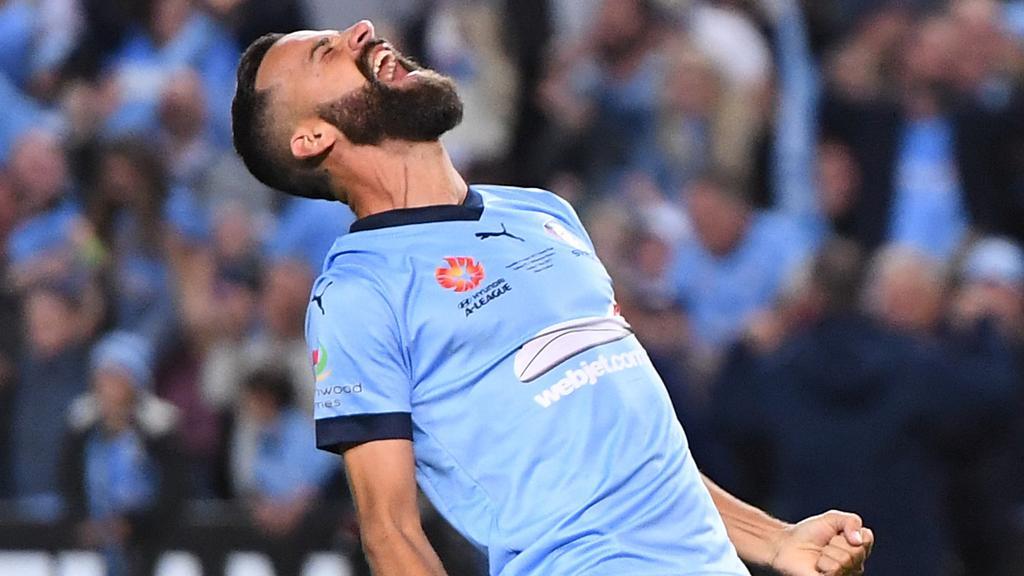 Captain Alex Brosque celebrates Sydney FC's A-League grand final win against Melbourne Victory at Allianz Stadium last season.