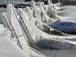 Ice covers the harbor wall and ships on the shore of Lake Constance, in Romanshorn Switzerland, Monday, Feb. 26, 2018. Picture: Walter Bieri/dpa via AP
