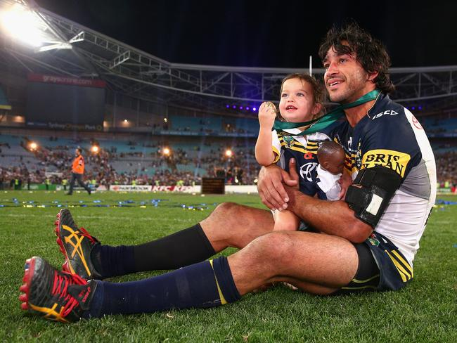 Cowboys captain Johnathan Thurston takes a moment in the centre of the field with his daughter Frankie Thurston after winning the 2015 NRL Grand Final on October 4, 2015. Picture: Cameron Spencer/Getty Images