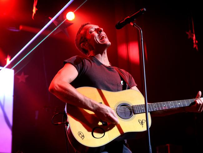 Singing his heart out ... Chris Martin from Coldplay in Sydney on their 2014 tour. Picture: Richard Dobson