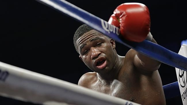 Adrien Broner stands dazed in a neutral corner after he was head-butted by Marcos Maidana in Round 8.