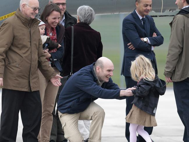French hostage Nicolas Henin meeting his daughter when released. Pic: AP.