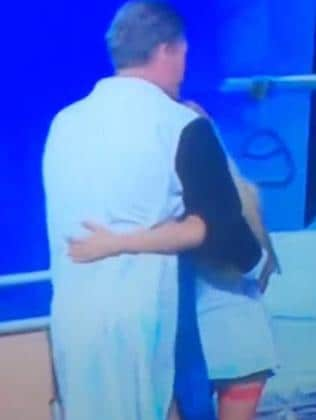 Social media lit up: Sam Newman and the scantily-clad nurse. Picture: Twitter