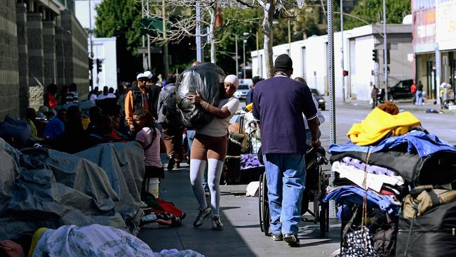 Homeless people and their belongings on a Skid Row footpath. There is a continual battle to stop unattended belongings being stolen, or cleaned up. Picture: Kevork Djansezian/Getty Images