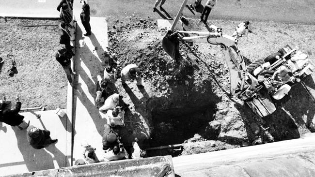 Inmates fill in the tunnel, that was dug by inmate Lanigan and co.
