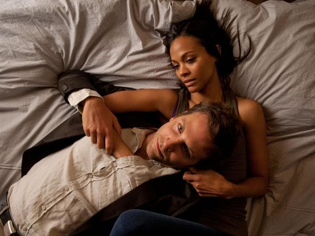 "Long over ... Bradley Cooper and Zoe Saldana in a scene from ""The Words""."
